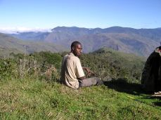The grassy hills far in the distant is Kerau Mission station, in Goilala